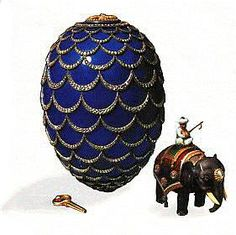 Faberge Kelch Pine Cone Egg 1900. Surprise is oxidized silver Indian elephant automaton with ivory tusks supporting an enameled turbaned mahout seated upon a gold fringed red and green guilloche enamel saddle cloth. Each side is set with three rose-cut diamond collets, one covers a keyhole. When wound with the original gold key, the tiny elephant, lumbers forward, shifting its weight from one side to the other, all the while turning its head and flicking its tail.