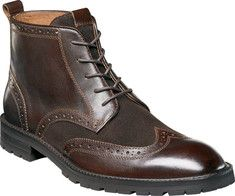 This lace-up wingtip boot features brogueing details, high quality uppers, leather linings, a Comfortechnology footbed, and a rubber sole.