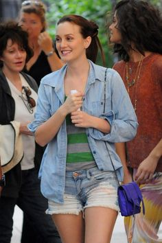 """Leighton Meester is cute and casual on the set of """"Gossip Girl"""". Her ripped mini denim shorts and shirt are matched with a grey and green striped top and a small purple purse. A happy mix of denim and color poppin'!"""