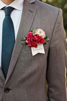 boutonniere on the pocket with a cute dovetail tag.