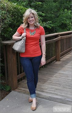 "A simple way to dress up ""Jeans and a T-shirt"" : heals and a necklace."