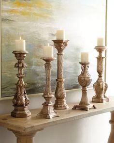 Five Opulent Silver-Washed Candlesticks