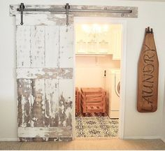 Barn door for laundry room- leave open when you don't have company- don't have to open a door with a load of laundry in your hands