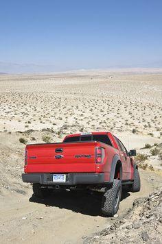 Ford F-150 SVT Raptor 4X4 in the desert / dunes. Looks hot, dry & sandy. Drink lots of water. #WhiteMarshFord