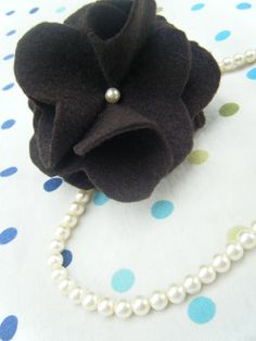 Felt Flowers.  You can use this flower for just about any thing! Wear it in your hair, pin it to a blouse, attach it to a necklace or bracelet, pin it to your purse or add it to a headband for a sweet baby accessory!