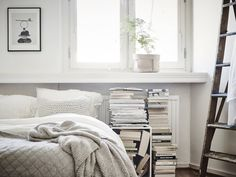 Love the bedding textures and the inevitable pile of books as decor  Emma hos
