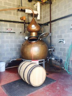 """Besides the gin, which will contain regionally sourced botanicals, Real Spirits also hopes to create a tequila-like spirit with agave from Mexico and a whiskey that Farbstein thinks will become the distillery's signature product. """"Our plan is to take our brewhouse barley and smoke it over peach wood from my neighbor and make a whiskey from that,"""" he says. Smaller-batch whiskeys are on the docket, too, using the washes — sans hops — from Real Ale beers… - Hoga pot still on the photo."""