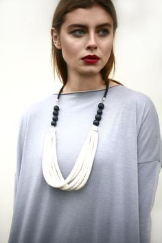 White cotton rope necklace on Etsy, $29.69Love the top, too!