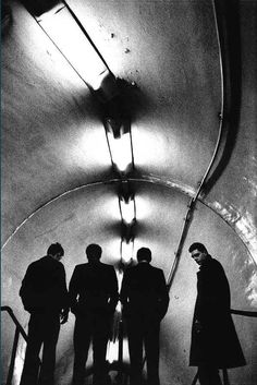 joy division photographed at lancaster gate tube by anton corbijn. in the dutch photographer directed a biopic of their lead singer, the late ian curtis, [original] © anton corbijn [website], from london. portrait of a city. Ian Curtis, Joy Division, Music Love, Music Is Life, Rock Music, Elvis Costello, Band Photography, Vintage Photography, Musician Photography