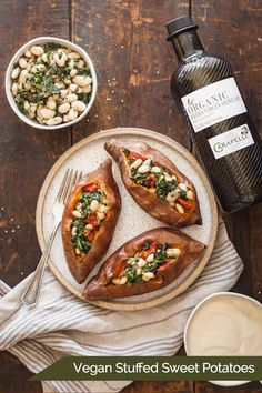 Vegan Stuffed Sweet Potatoes - A healthy dinner idea loaded with beans, veggies, and drizzled in rich olive oil and tahini sauce! Whole Foods Meal Plan, Whole Food Recipes, Cooking Recipes, Sweet Potato Toppings, Sweet Potato Recipes, Vegan Meal Plans, Vegan Meal Prep, Vegan Dishes, Vegan Food