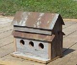 Amish Handmade Home and Garden Collectible Primitive Rustic Country Decor Birdhouse. A Very Unique Barnwood Birdhouse. This Birdhouse Is Made with Old Barnwood Siding, a Tin Roof and 3 Holes. Provide Your Feathered Friends a Safe Haven While Adding Warmth and Charm to Your Home, Porch, or Garden Landscape. Measures 13 1/2 X 13