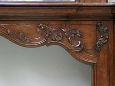 Oak mantle and trumeau with portrait of lady
