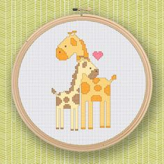 +This item is available for instant digital download*    Giraffe Family PDF File    Cross Stitch this lovely pattern into wonderful and