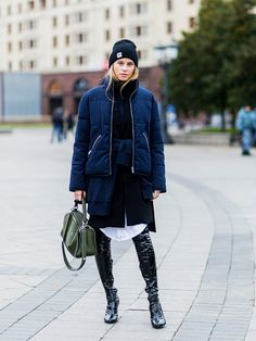 layering clothes: Tine Andrea wearing a puffa jacket and layered pieces