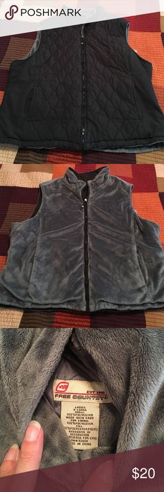 Free Country Reversible Vest Quilted black smooth polyester on one side and soft fuzzy gray faux fur polyester on the other. Size XL. Pockets on both side. Free Country Jackets & Coats Vests