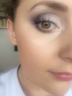a smokey eye using a mixture of whites, shimmers and then browns&burgundy in the crease and a black in the V