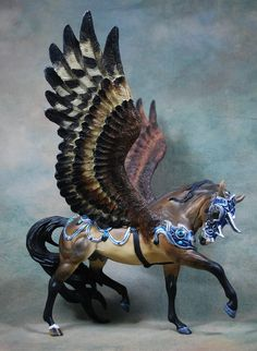 This was an older commission I started last year. A customized Breyer Esprit using Moody wings. only a few small changes *move front leg *moved head and neck *Moody wings *sculpted tack *new mane p...