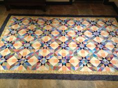 Scrappy Quilt - Pulsar Star Block.  What a great looking quilt.  Love the quilter's color choices.Scrappy Quilt - Pulsar