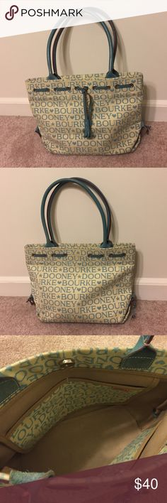 Dooney & Bourke Leather Blue Logo Bag Cute medium sized Tote Bag from Dooney & Bourke. Light blue logo design with blue strapes and detail tassles. 4 interior compartments. Overall good condition! Dooney & Bourke Bags Totes
