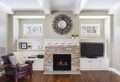 Classic Craftsman-style family room with hearth centered between window-topped shelving units.