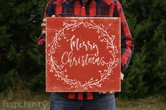 Merry Christmas Wreath - Wood Holiday Sign - Rustic Art on a Wood Panel  Not a Download // REAL Wall Decor that comes Ready to Hang!  Mounted Archival Print on Wood Panel  Available in one size: 16x16  Art is professionally printed on high quality paper with archival inks and then mounted to a sturdy 3/4 wood panel that is ready to hang. Colors may vary due to computer monitor calibrations.  Item ships within 3-5 days after order is placed.  Copyright ©RusticPrintCo