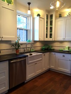 Custom white kitchen with inlay cabinets and soapstone countertops, Caldera Design LLC
