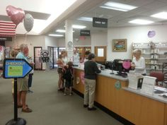 On a Friday afternoon at the Library, members are taking things home for their weekend entertainment.