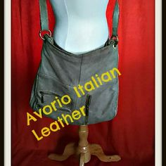 Gorgeous stone color Italian leather cross body This bag has been well loved but has life left. I listed pics of the whole bag in detail, even blemishes. Price reflects condition. I ship quick and love reasonable offers. Smoke and pet free, NO TRADES avorio Bags Crossbody Bags