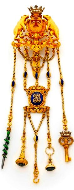 A mid-19th century enamel and 18K gold châtelaine,, worn by ladies who wanted to keep every day accessories on their person.