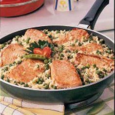 Pork Chops Over Rice - 4 oz. pork loin chops - canola oil - chicken broth - small onion - 10 oz. frozen peas - dried thyme