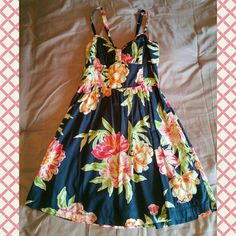 Hollister Navy Floral Dress Fit & Flare very flattering navy floral dress from Hollister. Only worn a few times, excellent condition! Straps can be tied halter style or regular with bow on back! Pink and orange flowers with green leaves! Hollister Dresses