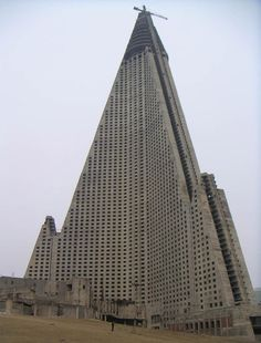 "The World's Worst Building: After the crumbling of the Communist bloc and the deterioration of the North Korean economy, construction halted after the outside of the hotel was complete. What remained for almost 2 decades was a window-less, empty shell of the hotel in the middle of Pyongyang, which media outlets called ""The Worst Building in the World"",""Hotel of Doom"" and ""Phantom Hotel""."