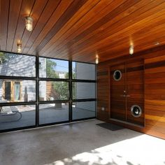 Mt Bonnell Residence Entrance Wooden Doors with Round Glass Walls