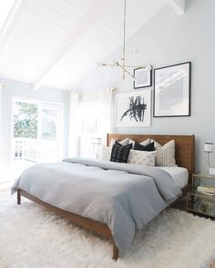 Black and white frames on bedroom wall