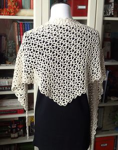 It is a sideway, asymmetrical, triangle shawl. The shape is inspired by my knitted Mundane pattern.