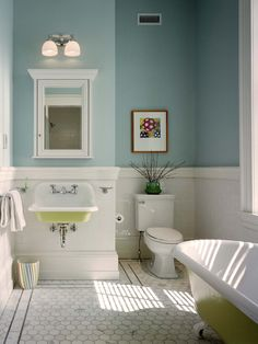 Elegant kids bathroom photo in Philadelphia with a claw-foot tub, subway tile, a wall-mount sink and blue walls