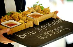 Chalkboard serving trays for the passed hors d'oeuvres to let guests know what appetizers are coming.