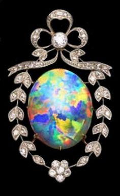 A Belle Epoque opal & diamond brooch, ca The oval-shaped crystal opal cabochon, x x displaying exceptional play-of-color of all spectral colors, set within a ribbon & floral garland surround, mounted throughout with millegrain single-cut diamonds. Edwardian Jewelry, Antique Jewelry, Vintage Jewelry, Antique Rings, Bijoux Art Nouveau, Art Nouveau Jewelry, Opal Jewelry, Silver Jewelry, Fine Jewelry