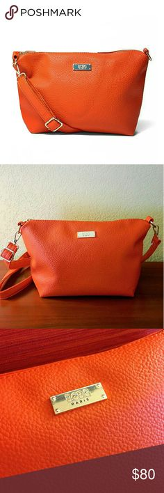 49✂BCBG Paris Clutch Crossbody Orange Bag ✨NWT, but not attached Got torn off when I was taking picture   ⏩Made from high-grade PU leather, this bag features rich vibrant orange color that's so perfect for Fall!  ⏩Polished BCBG paris plaque in front ⏩Top zip closure, goldtone hardware ⏩Interior ➖1 zip pocket,2 slip pockets,fully lined ⏩So versatile! Adjustable, detachable strap lets you convert the clutch into crossbody ⏩Sweet & simple, this bag isperfect for your quick trips outin the day…