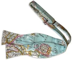 World Map Bow Tie in Sky Blue / Custom Wedding Bow Ties / Handmade Each VIVID piece is unique. I had-stitched this dreamy bow tie from a beautiful world map fabric, with a pastel sky blue background.