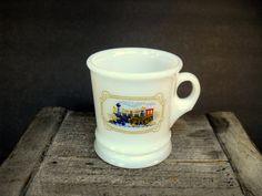 Hey, I found this really awesome Etsy listing at https://www.etsy.com/listing/166055803/avon-milk-glass-train-mug-vintage-gift