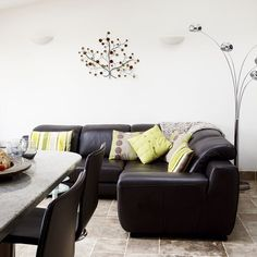 black furniture with colorful pillows