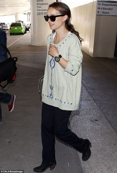 Natalie Portman at the airport in Los Angeles, California after her regular journey over from France, May 2013.