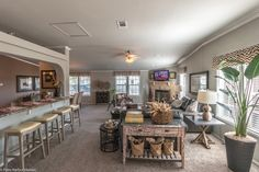 The family room unfolds with plenty of room for everyone - - and their friends! In the La Linda manufactured home by Palm Harbor with 3 Bedrooms, 2 Baths, 2280 Sq. Ft.