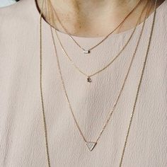 Delicate necklaces layered to great effect