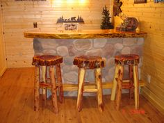 Log bar stools, and also the river rock bar and slab top    http://www.wardsriversidecabins.com/furniture/pages/other-furniture/bar-and-barstools.php