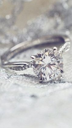 Love the graceful diamond accents on this stunning diamond engagement ring.