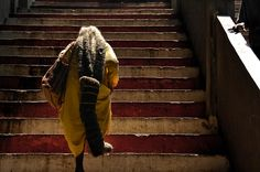 The final stairs in the 272-step ascent in the Batu Caves - she's never cut her hair. Stuck in Customs