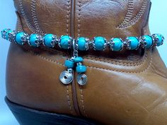 This boot bracelet you can wear with just about any boot style or color. It is actually strung on wire so it will not lose its shape. Fits so nicely and so sturdy. Bracelet is 13 long and the charms are approximately 1 1/2 long. There is room for about 1 tuck in or let out so if adjustment is needed, easy to fix, just let me know before shipping. Please check sizing before you buy..everyone is different in boot ankle size due to your shoe size. The boot in this picture is a size 7.  Thank…