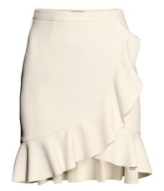 Frilled skirt $34.95 Description  Knee-length skirt in a lightly textured stretch weave with a wraparound front section, frill trim, and ...